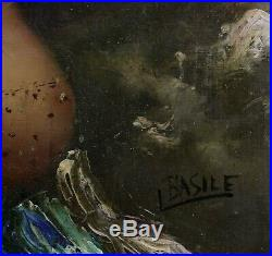 Huile sur toile représentant une femme seins nus signée en bas à droite BASILE